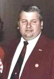 John Wayne Gacy in red suit
