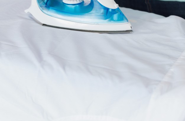 woman-ironing-clothes_13339-11926