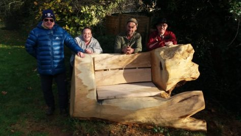Mick Allsopp, Nyomie Flecknell, the carver and Roy Adams with the bench