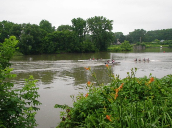 orange -crew sculls with daylilies on the Mohawk - 02July09