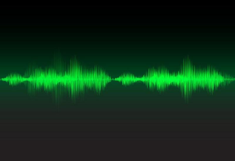 Green sound waves glow light