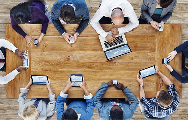 group of people on smartphones and tablets