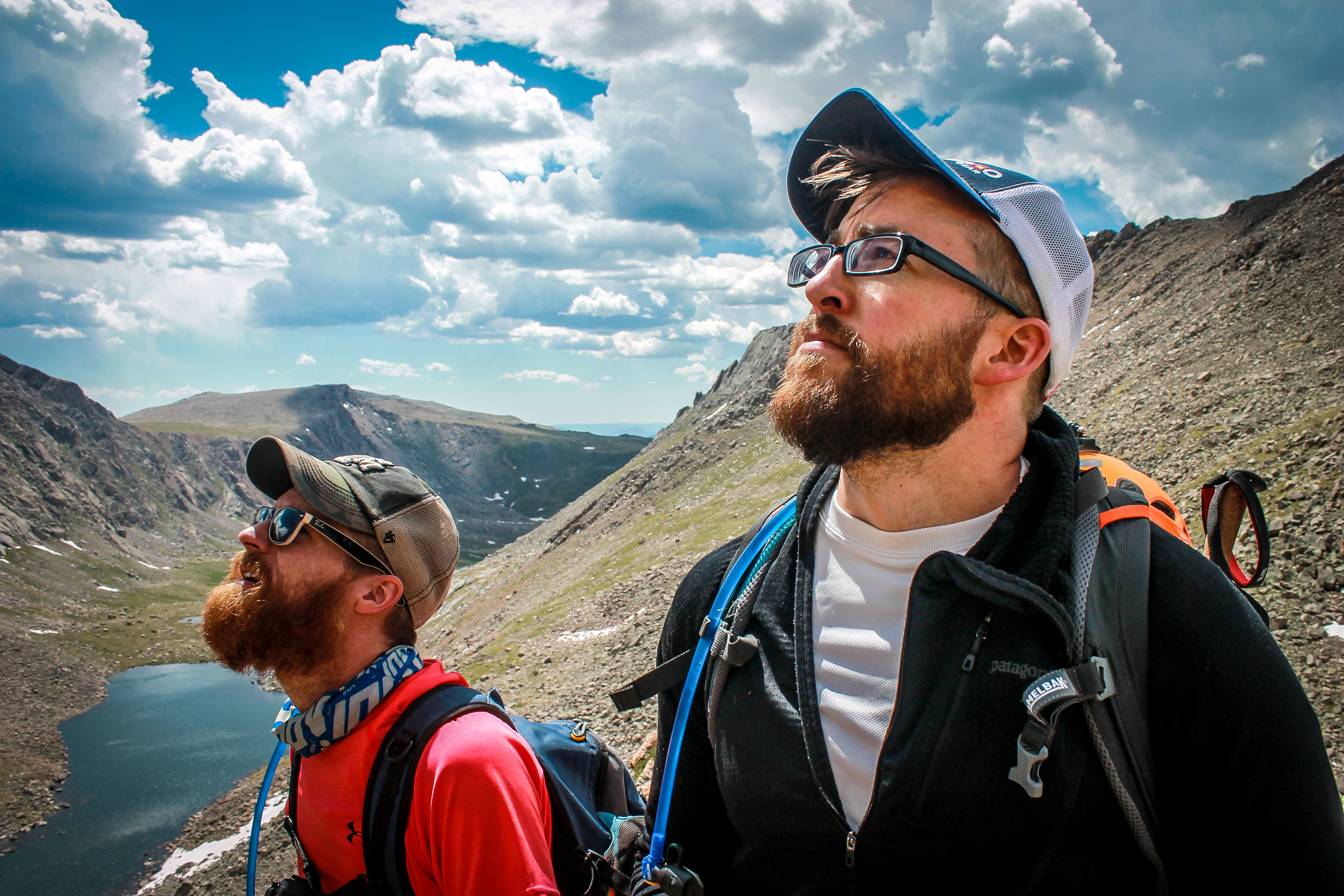 men climbing mountains together sharing bonding experience