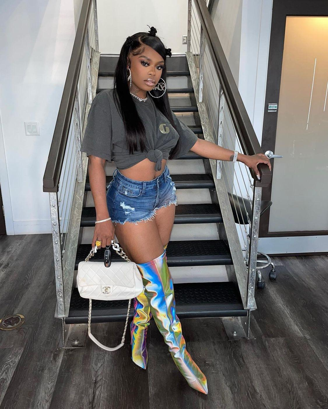 Wardrobe Inquiry: Dreezy's Multicolor Reflective Over the Knee Boots