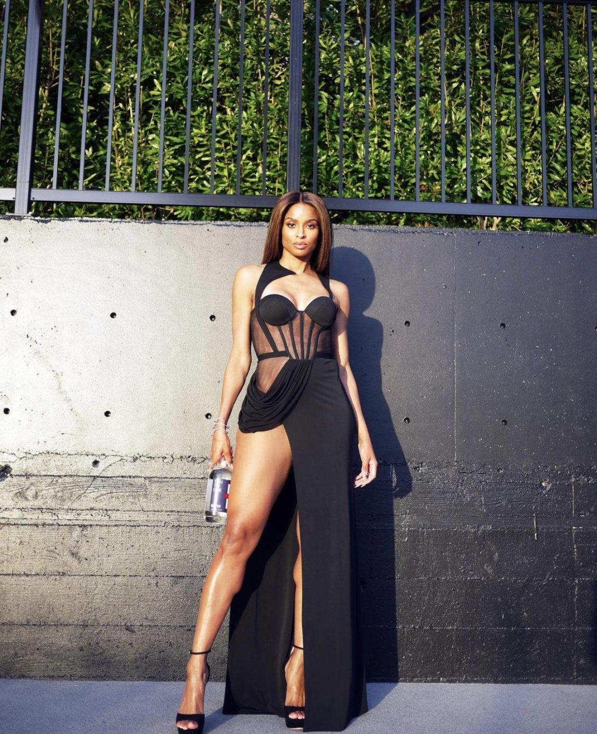 Most Requested: Ciara Displays Her Legs in Alon Livné Black Draped Corset Dress While Announcing Her Latest Business Venture With Ten To One Rum