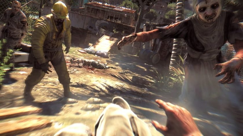 Dying Light. The player is knocked to the ground with zombies quickly closing in on them.
