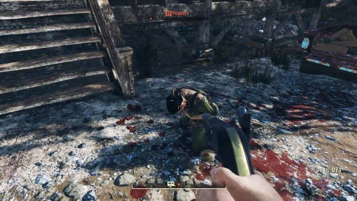 Another kneeling defeated player with a gun being pointed at them.