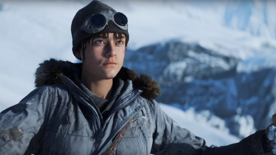 A woman stands with her hands in the air amid a snowy landscape in Battlefield V
