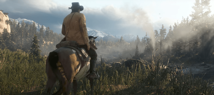 Arthur sits atop a horse overlooking the beautiful land scape in Red Dead Redemption 2.