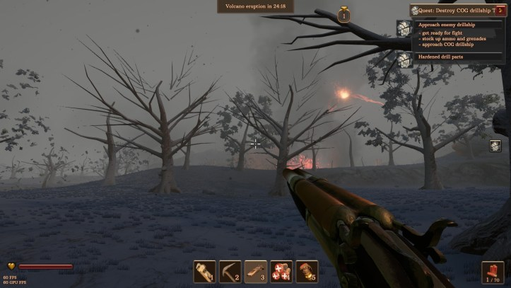 The player explores a burnt forest after a volcano eruption.