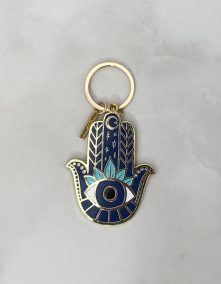 A Hamsa Keychain which represents power and strength, and is a symbol of protection, is a great gift for someone who just moved.