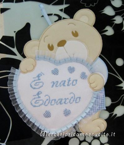 Coccarda fiocco nascita orsetto con cuore celeste E' nato Edoardo