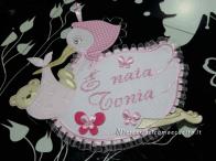 Fiocco nascita cicgona rosa, busta portaoggetti trapuntata e babbucce per Tonia