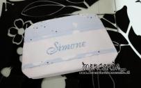Bustina fantasia con nuvole e bavetta prima misura per Simone