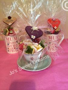 Image showing to sweet gifts with mugs and one gift using a cup and saucer to hold the treats of your choice.
