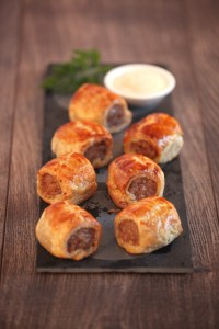 Party Foods. Image showing Mini Artisan Sausage Rolls on board