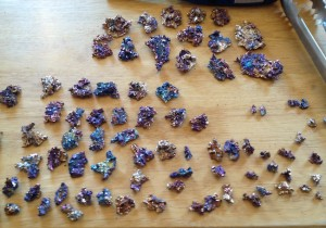 The finished crystals are sorted by size and color.