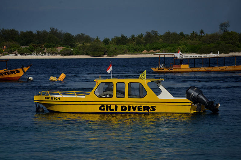 The Bitch, smallest of Gili Divers fleet in front of Mt. Rinjani