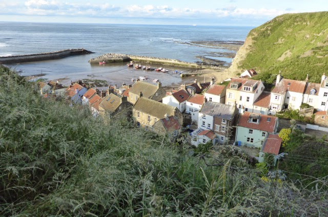 Staithes nestled between the cliffs