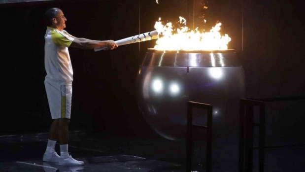 The cannonball-shaped cauldron was lit by Vanderlei Cordeiro de Lima, a Brazilian marathoner who was famously tackled by a spectator as he was leading the 2004 games.