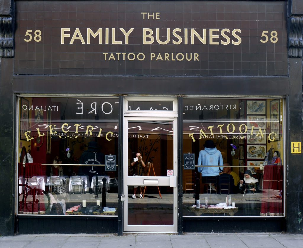 shop front of The Family Business Tatto Parlour Photo by Brett Jordan on Unsplash
