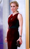 """Gillian Anderson poses as she arrives for the world premiere of """"The Crown"""" at Leicester Square in London, Britain November 1, 2016. REUTERS/Eddie Keogh"""
