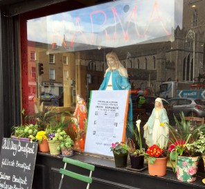 Bizarre window of Karma - 3 statues of Mary, one holding the proclamation