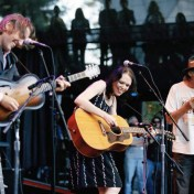 "David Rawlings, Gillian Welch, and Neil Young play ""Country Girl"" at the Bridge Concert 2006."
