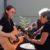 "Gillian Welch and Joan Baez rooftop rehearsal of ""Joe Hill""."