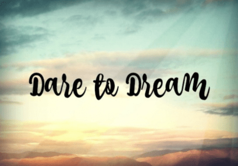 dare to dream text over clouds
