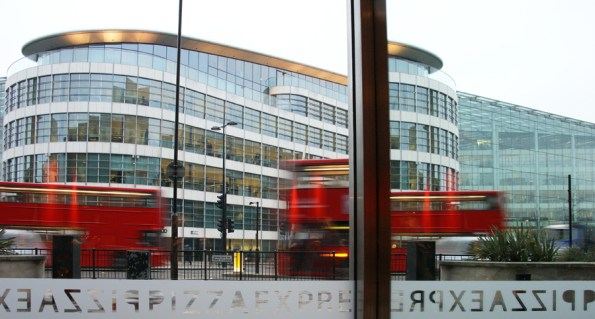 Red buses reflected