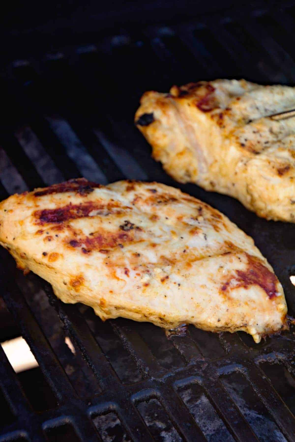 Grilled Caesar Chicken breats on grill