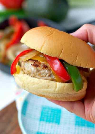 Hand holding chicken fajita burger