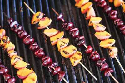 Peach and cherry skewers on the grill