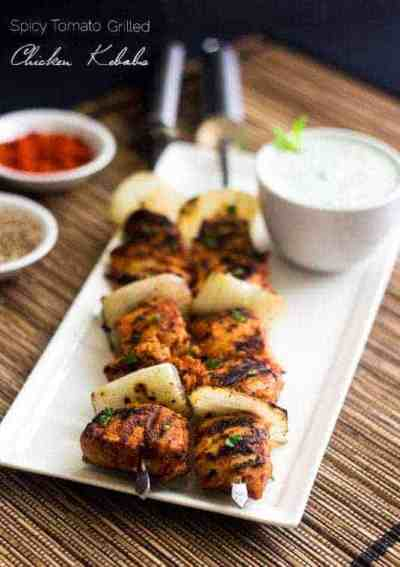 Spicy grilled tomato chicken kabobs on plate