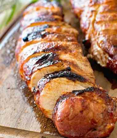grilled pork loin slices on cutting board