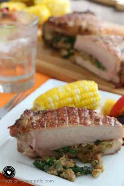 Grilled stuffed pork chop and corn on the cob