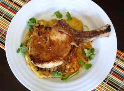 Sweet and spicy pineapple grilled pork chop on plate