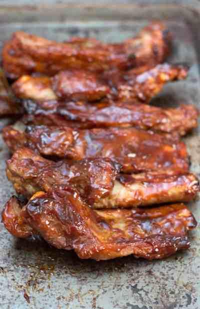 Sticky glazed ribs on baking sheet