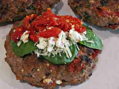 Spinach, feta, bacon burger on a plate