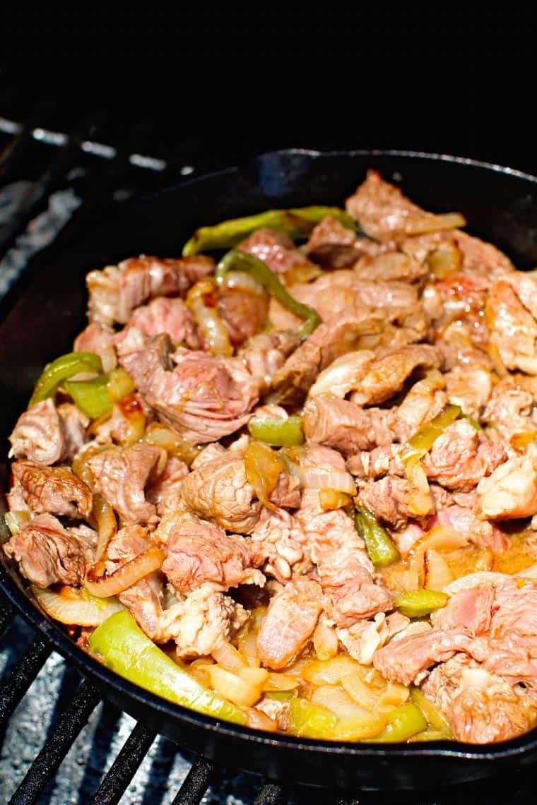 Steak onion green peppers on smoker