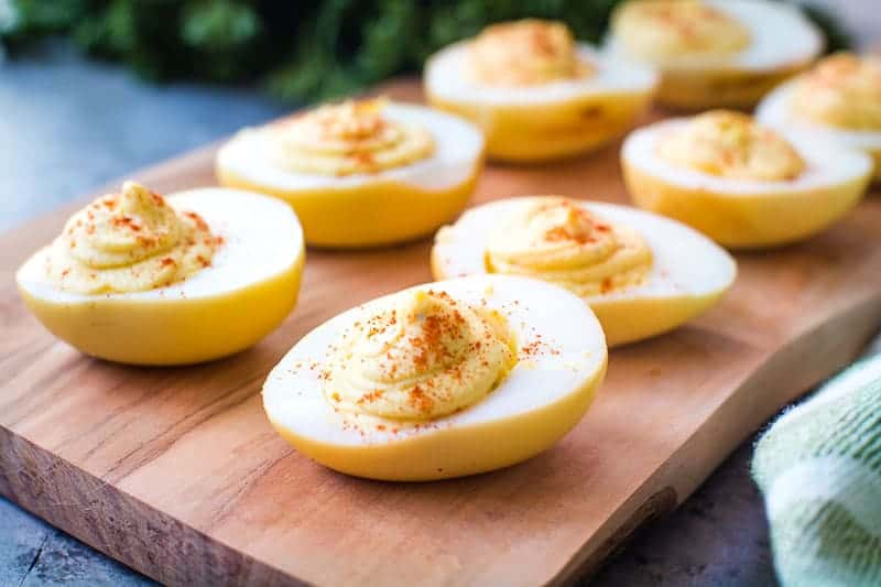 Smoked Deviled Eggs on wood cutting board