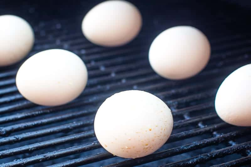 Eggs being hard boiled on pellet grill rack
