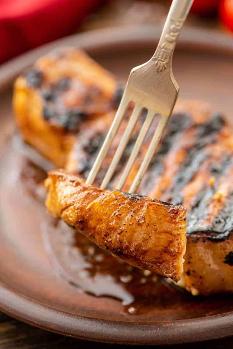 Piece of Grill-Pork-Chops on fork
