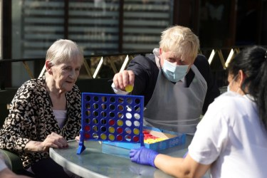 Boris Johnson playing Connect 4 with an elderly lady and a nurse whilst visit Westport Care Home in East London 7/9/21