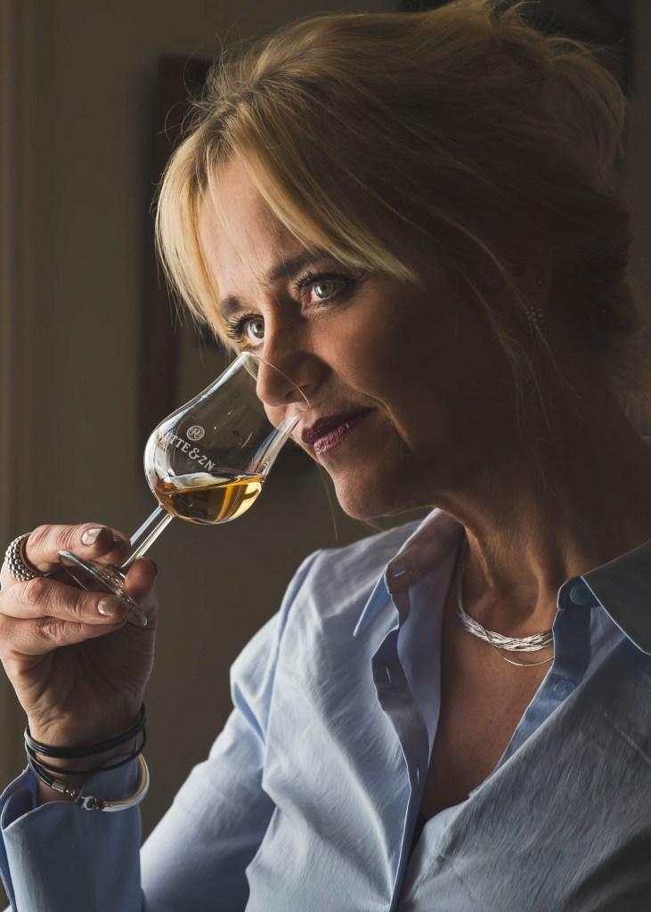 Myriam Hendrickx of Rutte noses a glass of spirit