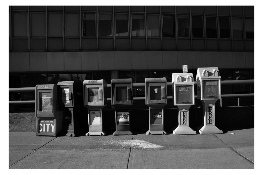 newspaper boxes on a street