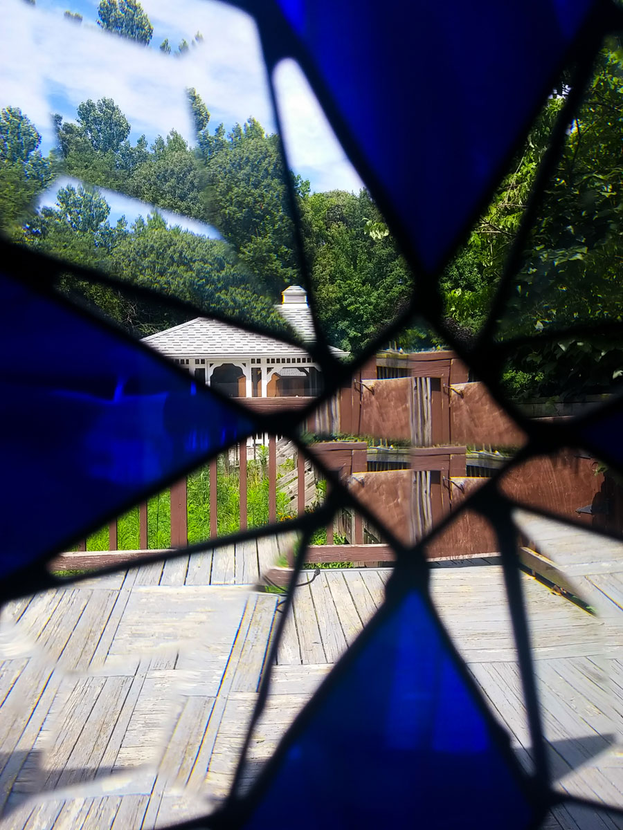view of a backyard through stained glass