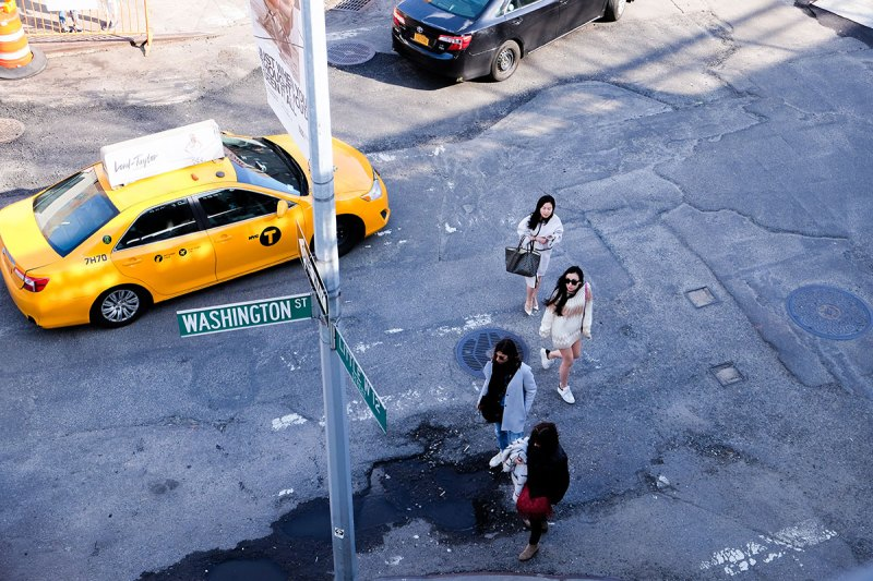 women cross the street to the Highline