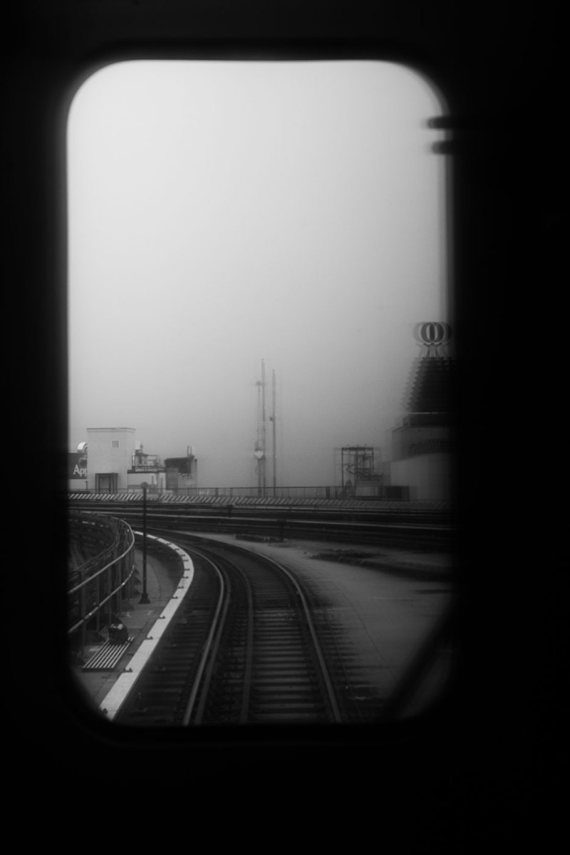 a view of Coney Island from the back of a train window